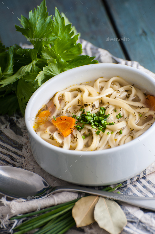 Homemade chicken soup with homemade noodles. - Stock Photo - Images