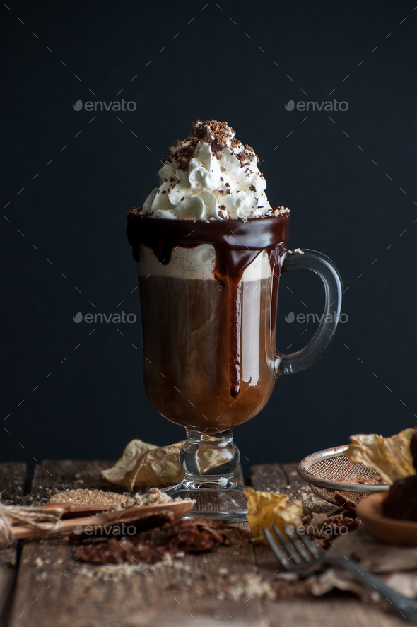 Coffee with whipped cream and chocolate on an old wooden table. - Stock Photo - Images