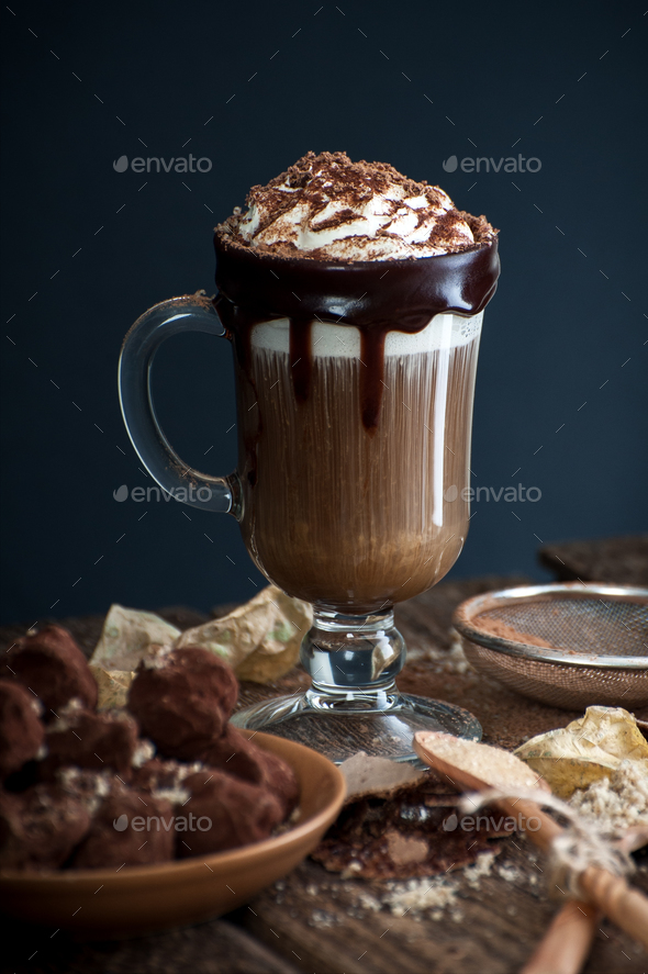 Coffee with cream and sloppy crumbs on an old wooden table. - Stock Photo - Images