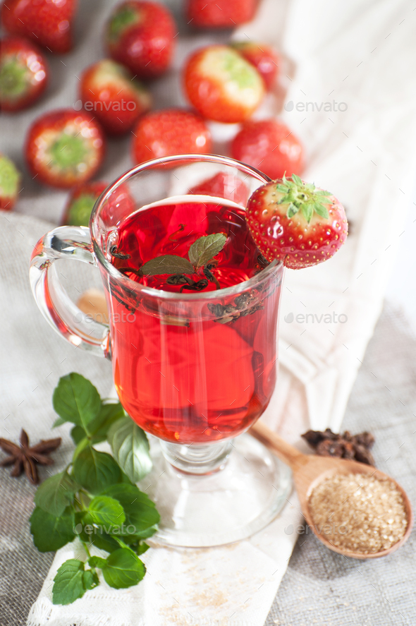Freshly brewed cup of strawberry tea with fresh mint. - Stock Photo - Images