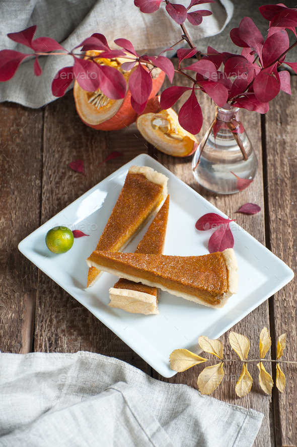 Three slices of pumpkin pie on a white plate. - Stock Photo - Images
