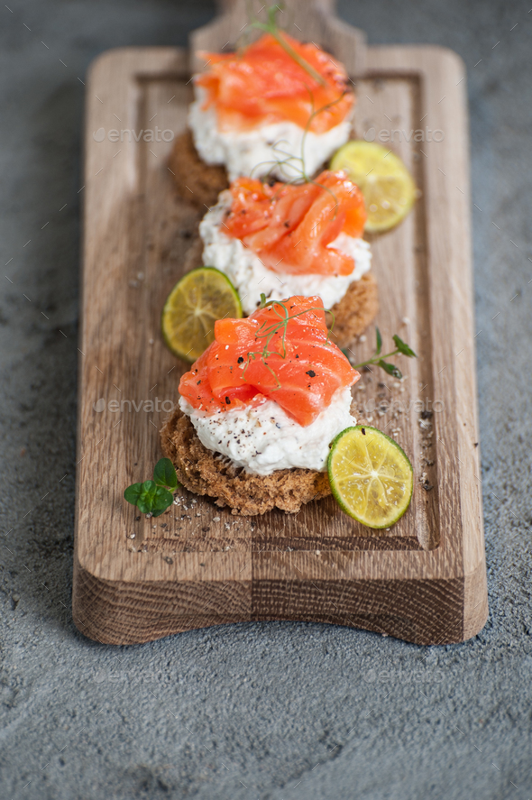 Miniature toasts with lightly salted salmon and cottage cheese c - Stock Photo - Images