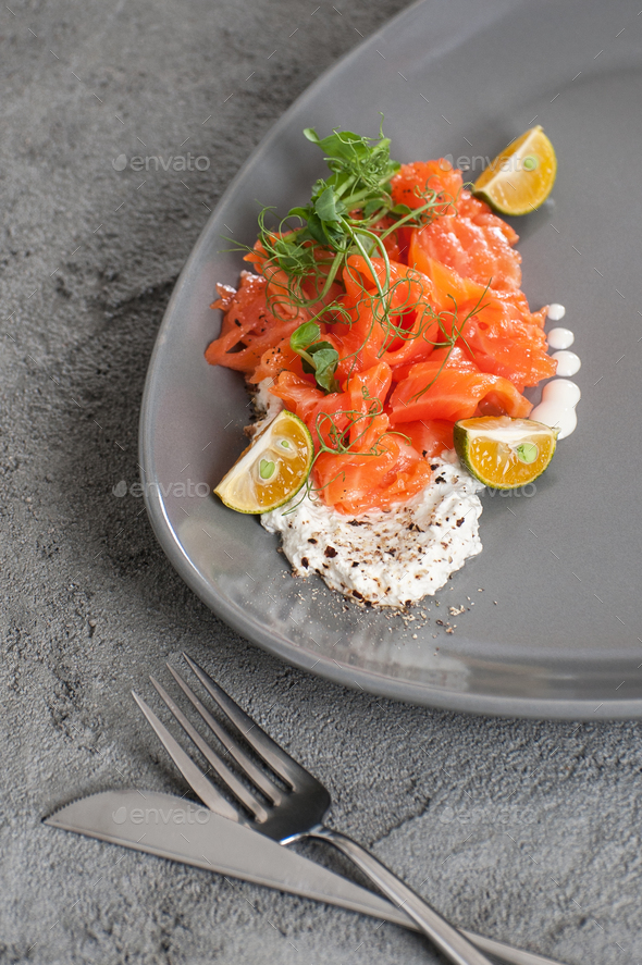 Lightly salted salmon with cottage cheese cream and limequat. - Stock Photo - Images