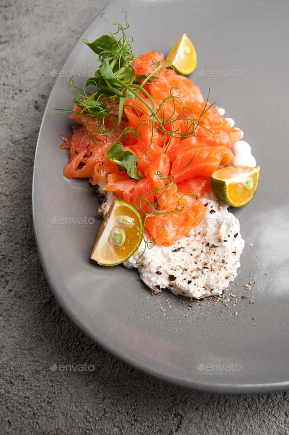 Lightly salted salmon with cottage cheese cream and limequat is - Stock Photo - Images