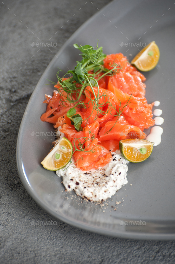Salad from slightly salted salmon with cottage cheese cream and - Stock Photo - Images