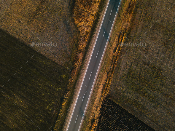 Aerial view of empty road through countryside - Stock Photo - Images