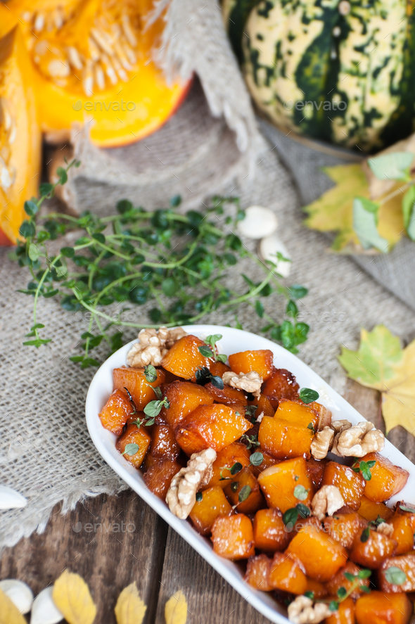 Сaramelized pumpkin with honey, walnut and thyme. - Stock Photo - Images