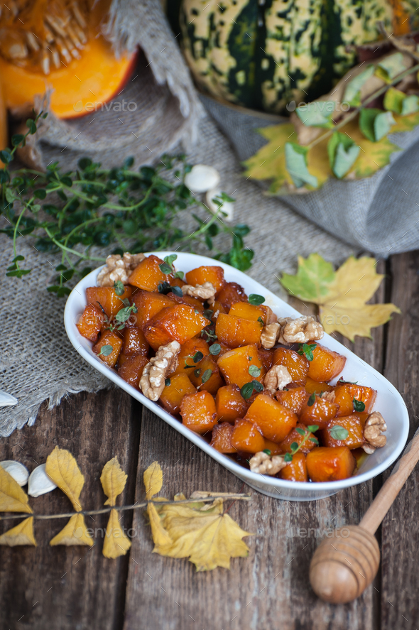 Baked pieces of pumpkin with honey, walnuts and thyme. - Stock Photo - Images
