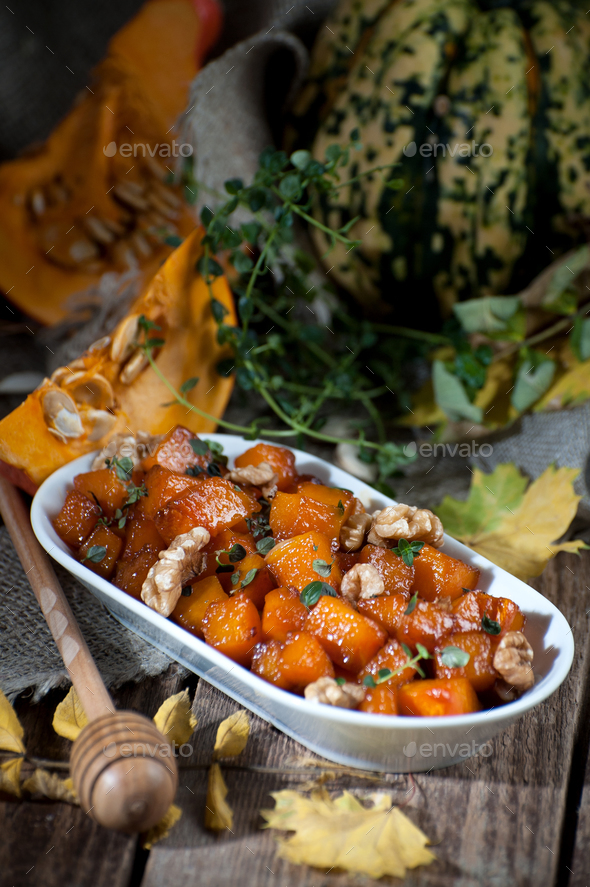 Caramelized pumpkin with honey, nuts and thyme leaves. Shooting - Stock Photo - Images