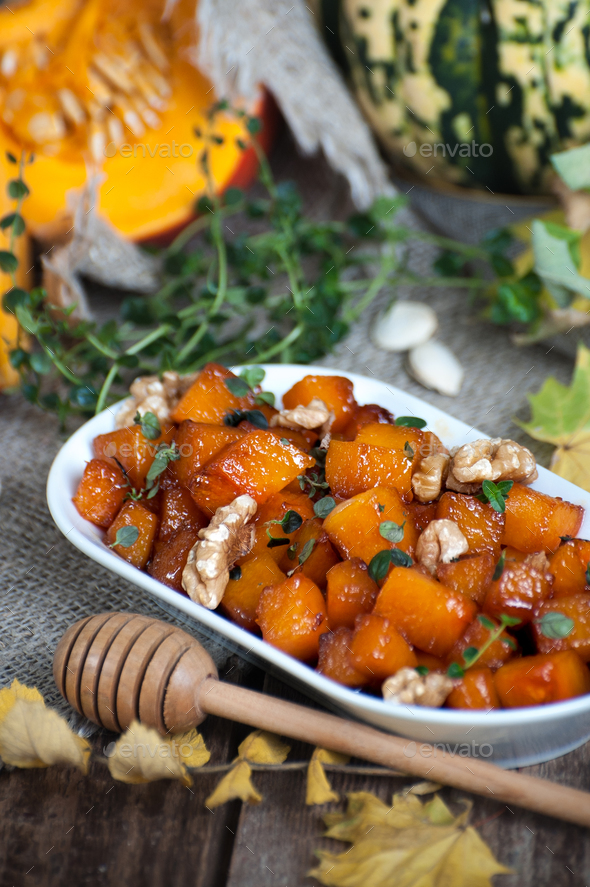 Pieces of caramelized pumpkin with honey, walnuts and thyme. - Stock Photo - Images