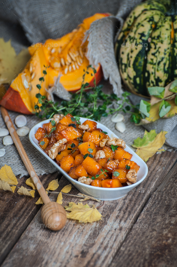 Appetizer from caramelized pumpkin with honey, walnut and thyme. - Stock Photo - Images