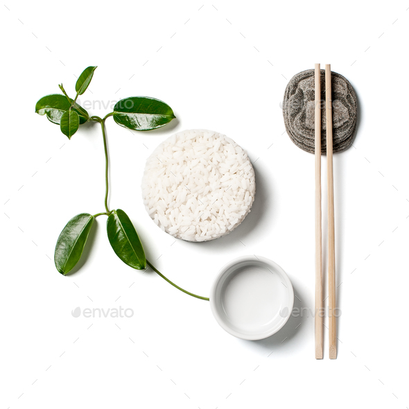 White rice, chopsticks and a branch of a young plant on a white - Stock Photo - Images
