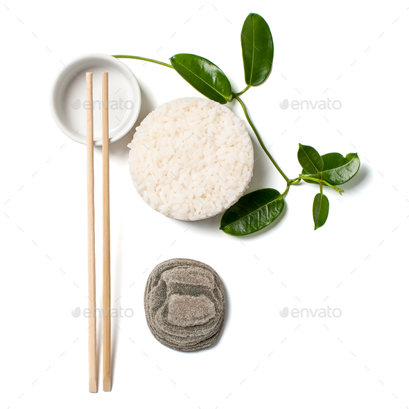 Minimalistic composition with white rice and chopsticks on white - Stock Photo - Images