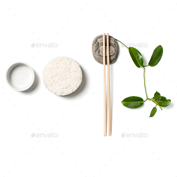 Composition with white rice and chopsticks on white background. - Stock Photo - Images
