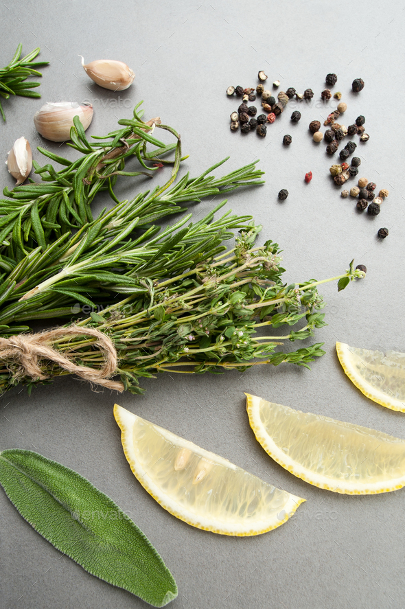 Fresh spicy herbs, a mixture of peppers, garlic and lemon on a g - Stock Photo - Images