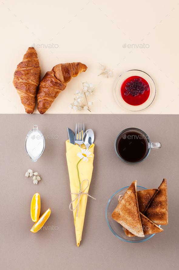 Black coffee, cream, croissants, jam and fresh fruit on a light - Stock Photo - Images