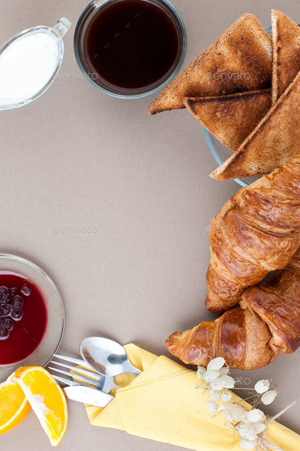 Black coffee, milk, croissants, jam, fruit and toast on a light - Stock Photo - Images