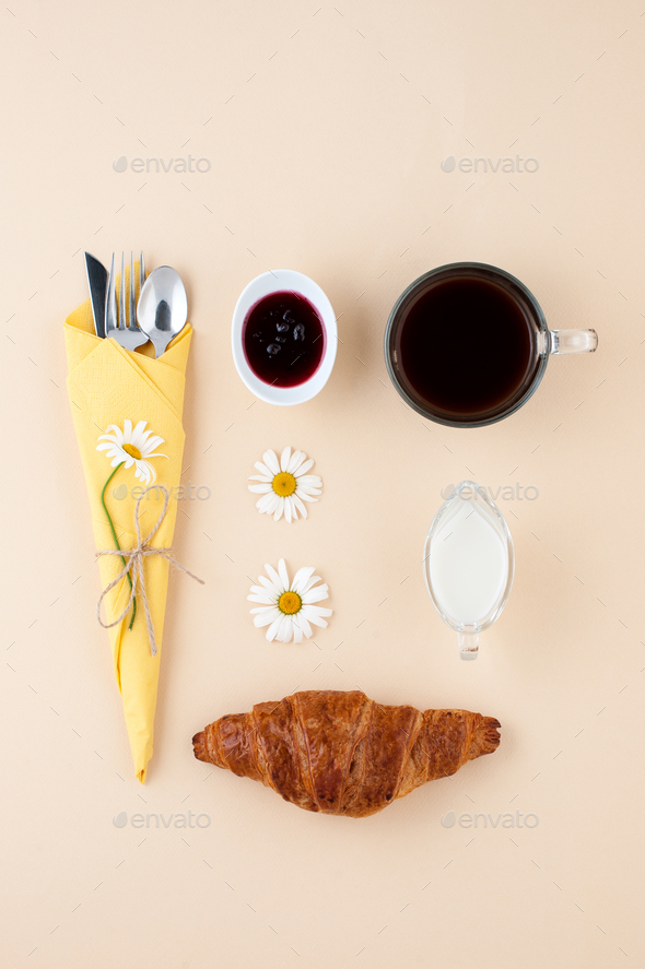 Black coffee, milk, fresh croissant and jam on a light yellow ba - Stock Photo - Images