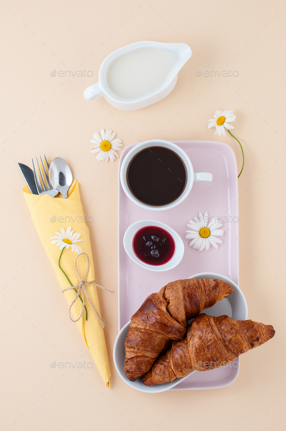French breakfast: black coffee, milk and a croissant with jam se - Stock Photo - Images