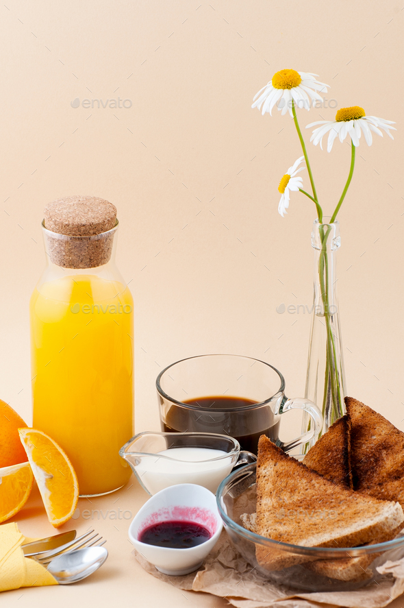Set for breakfast: black coffee, milk, toast with jam, orange ju - Stock Photo - Images