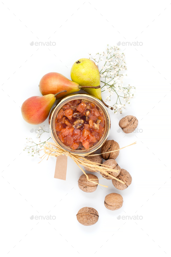 Pear jam in a glass jar on a white background top view. - Stock Photo - Images
