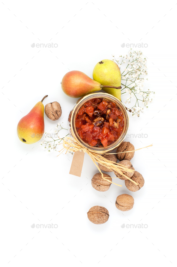 Pear jam, pears and walnuts on a white background top view. - Stock Photo - Images