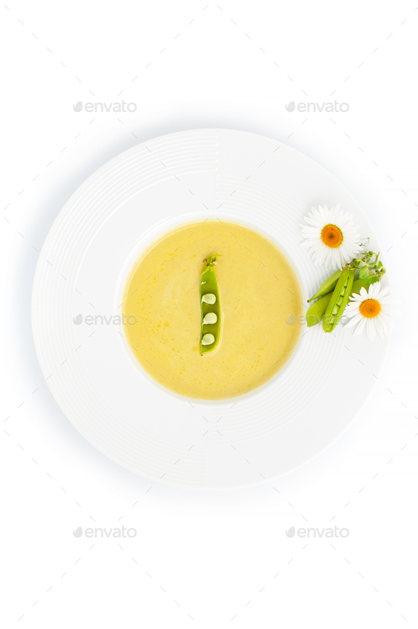 Green cream soup from a young pot, served with pea sticks and ch - Stock Photo - Images