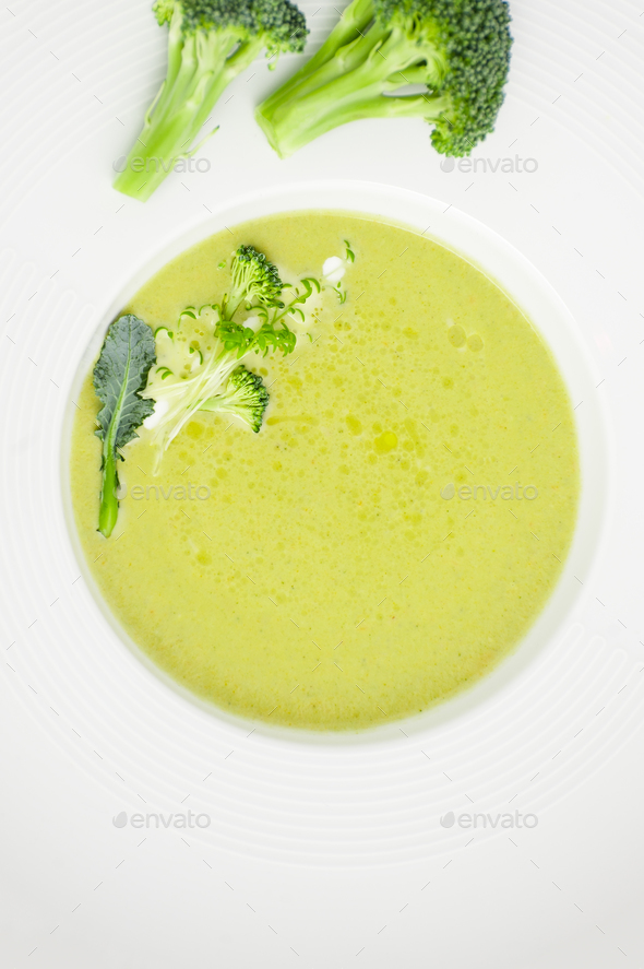 Cream of broccoli soup close-up in a white plate. - Stock Photo - Images