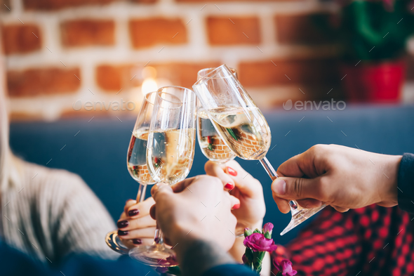 Four glasses of champagne in a toast - Stock Photo - Images