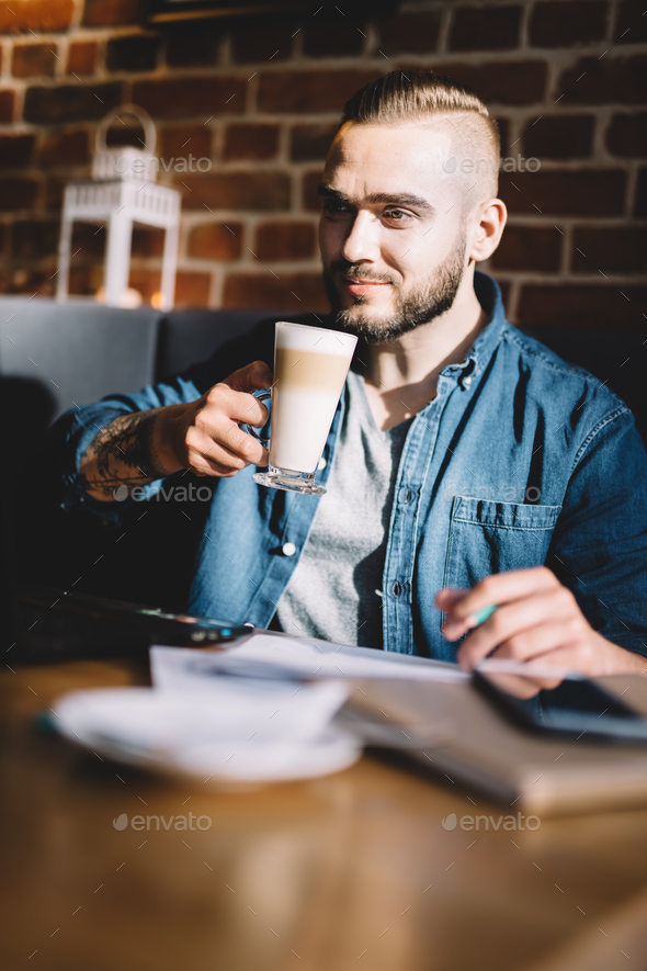 Man drinking coffee in a restaurant. - Stock Photo - Images