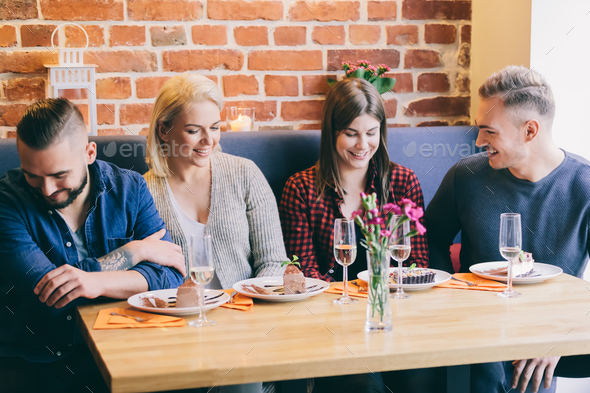 Friends chatting together in a cafe - Stock Photo - Images