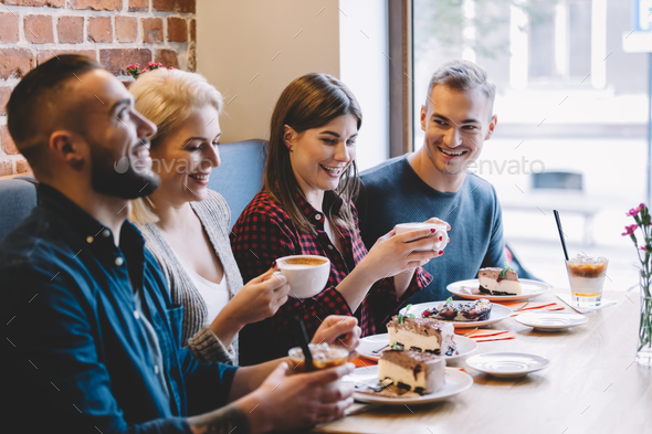 People eating in a restaurant, laughing - Stock Photo - Images