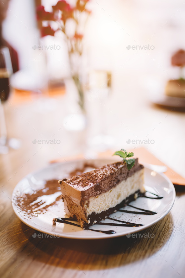 Slice of cheesecake served on a decorated plate. - Stock Photo - Images