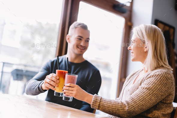 Young couple with a drink spending time together. - Stock Photo - Images