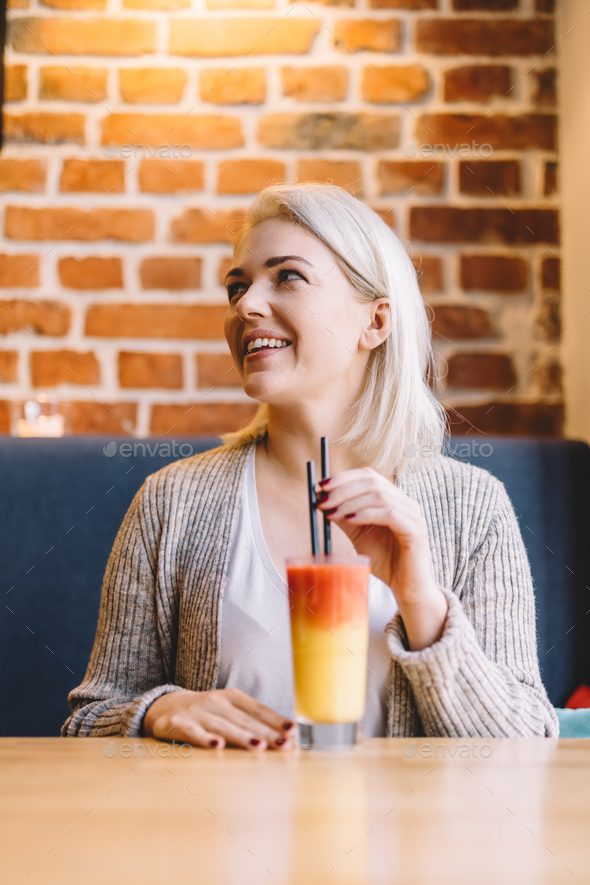 Woman drinking healthy refreshing juice. - Stock Photo - Images