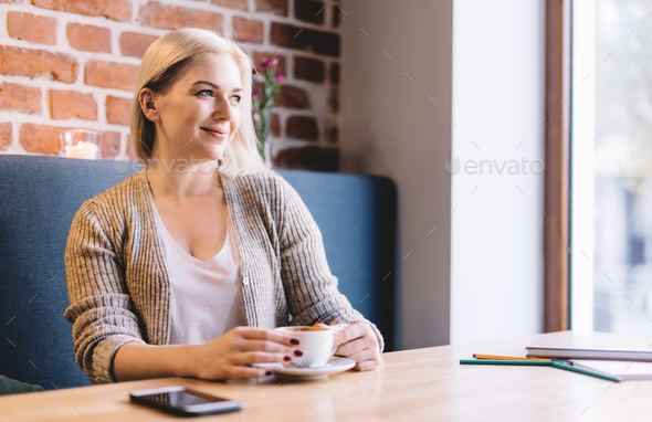 Relaxed woman drinking coffee in a cafe. - Stock Photo - Images