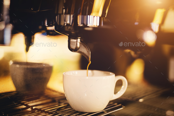 A cup of coffee straight from a coffee machine. - Stock Photo - Images