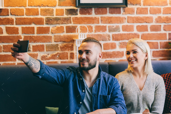 Man taking a selfie with a woman. - Stock Photo - Images