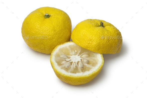 Fresh yellow whole and half Japanese Yuzu - Stock Photo - Images