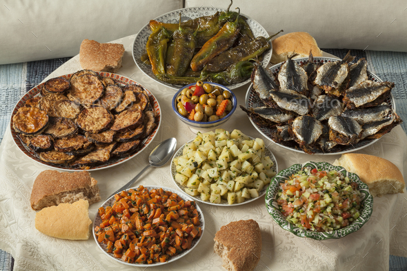 Moroccan meal with a variety of dishes - Stock Photo - Images