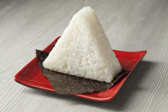 Fresh made Japanese triangular onigiri on seaweed - Stock Photo - Images