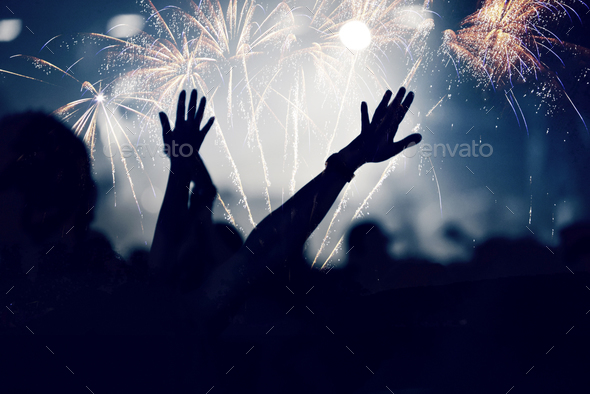 Cheering crowd and fireworks - Stock Photo - Images