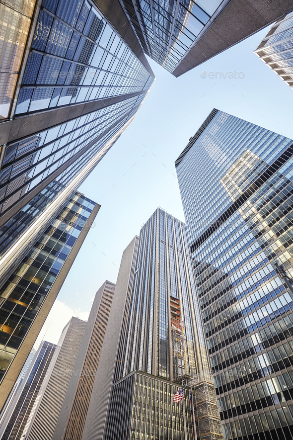 Looking up at New York City skyscrapers, USA - Stock Photo - Images