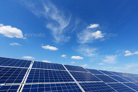 Solar panel on blue sky background - Stock Photo - Images