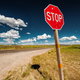 Stop sign on empty highway in Wyoming - PhotoDune Item for Sale
