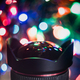Christmas Light Reflection in a Camera Lens - PhotoDune Item for Sale