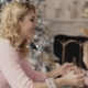 Young Mother Plays with Her Daughter Near the Christmas Tree - VideoHive Item for Sale