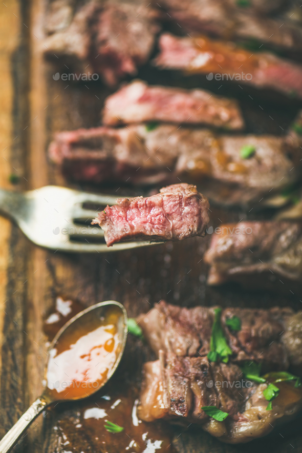 Grilled ribeye beef steak peice on fork - Stock Photo - Images