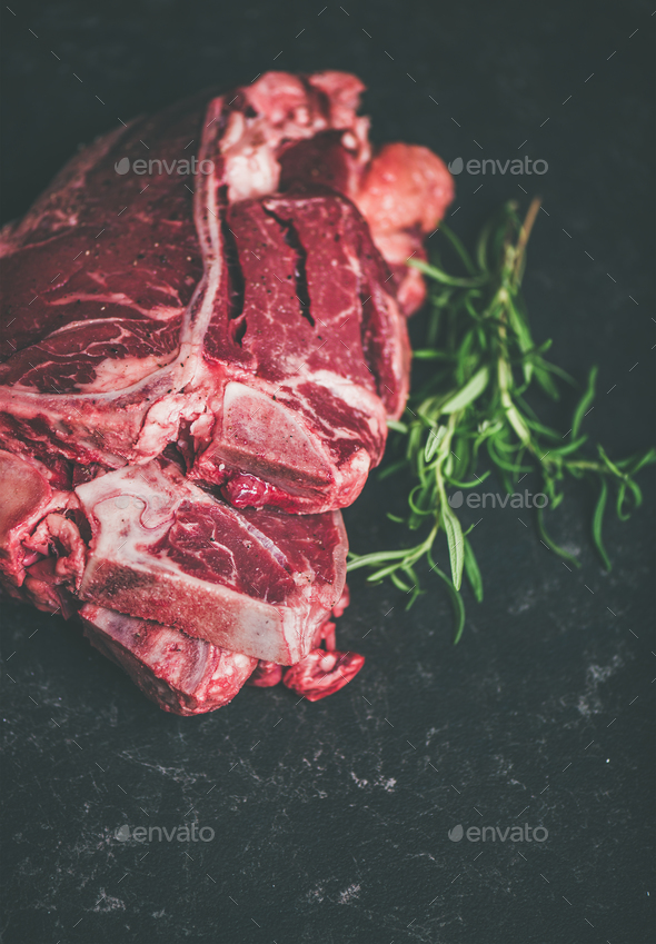 Raw beef meat t-bone steaks with rosemary, copy space - Stock Photo - Images