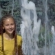 The Girl Splashes in the Fountain - VideoHive Item for Sale
